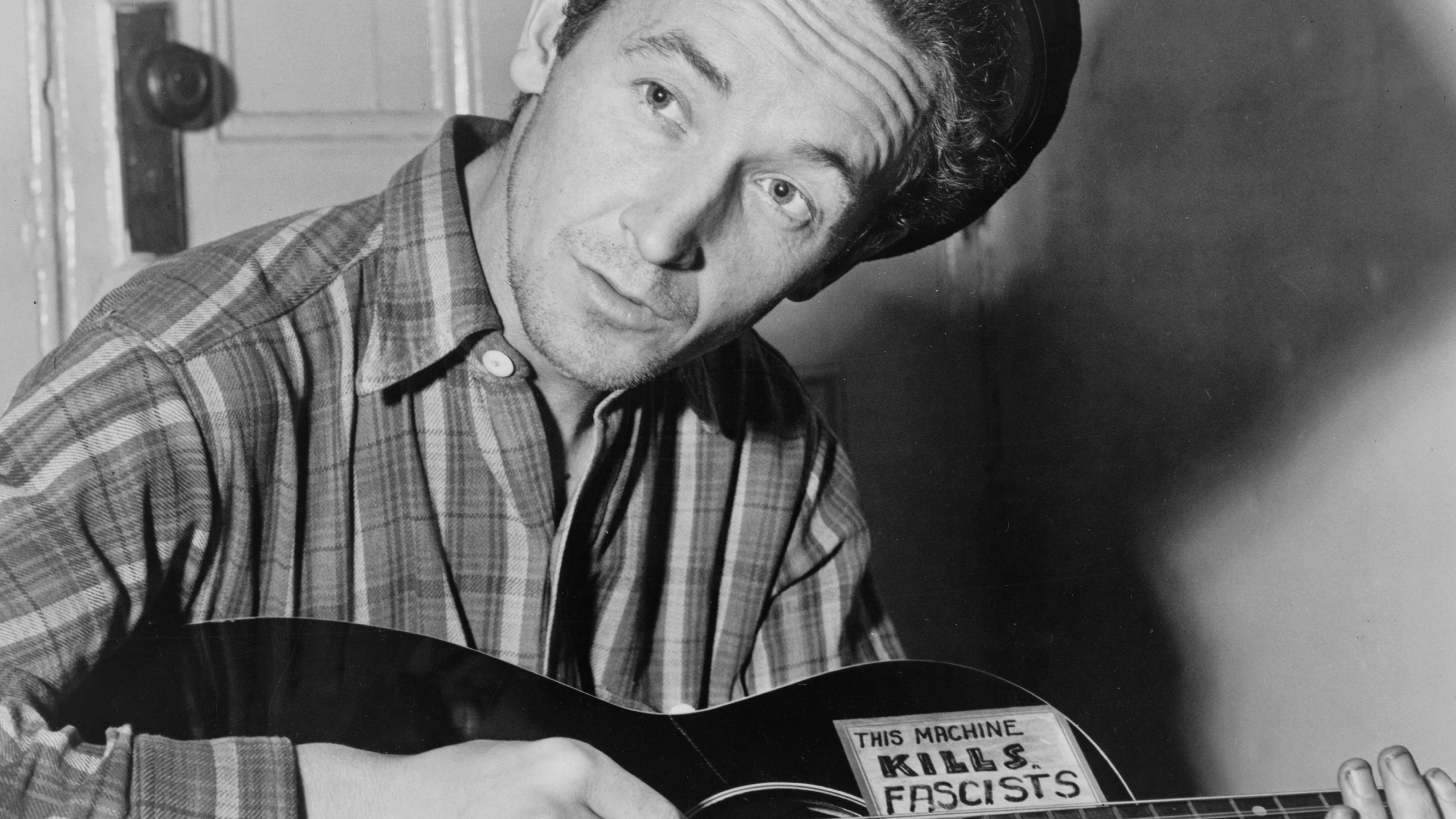 Portrait photograph of Woody Guthrie (Woodrow Wilson Guthrie) (1912-1967) American singer-songwriter. Dated 1943 Photo by: (U