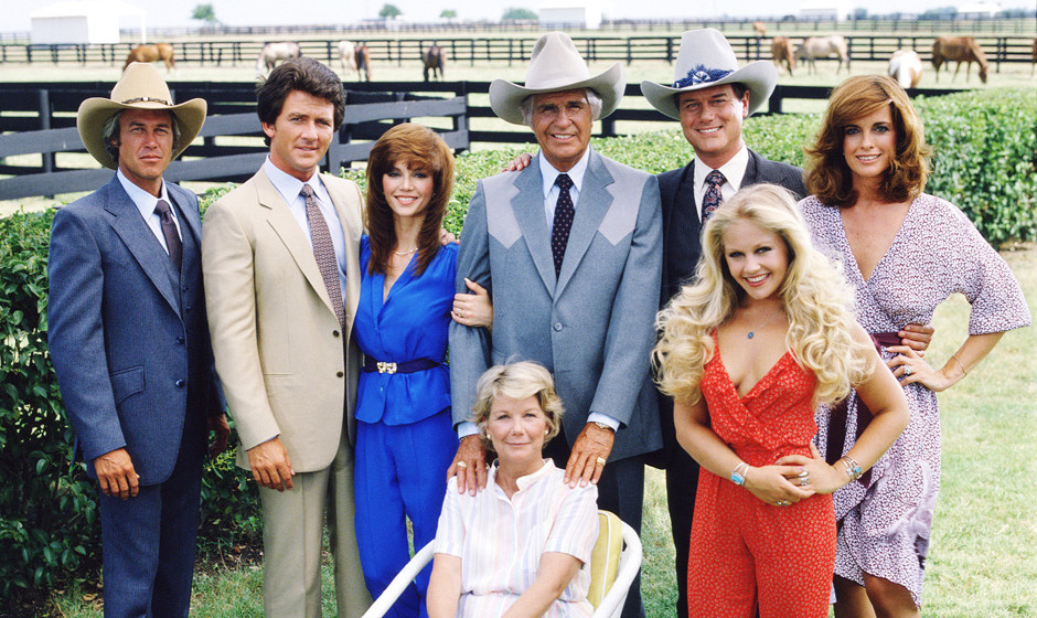DALLAS cast members (standing, from left) Steve Kanaly (as Ray Krebbs); Patrick Duffy (as Bobby Ewing); Victoria Principal (a