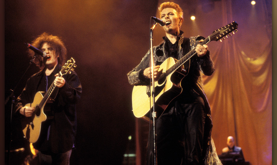 Robert Smith and David Bowie during David Bowie's 50th Birthday Celebration Concert at Madison Square Garden in New York City