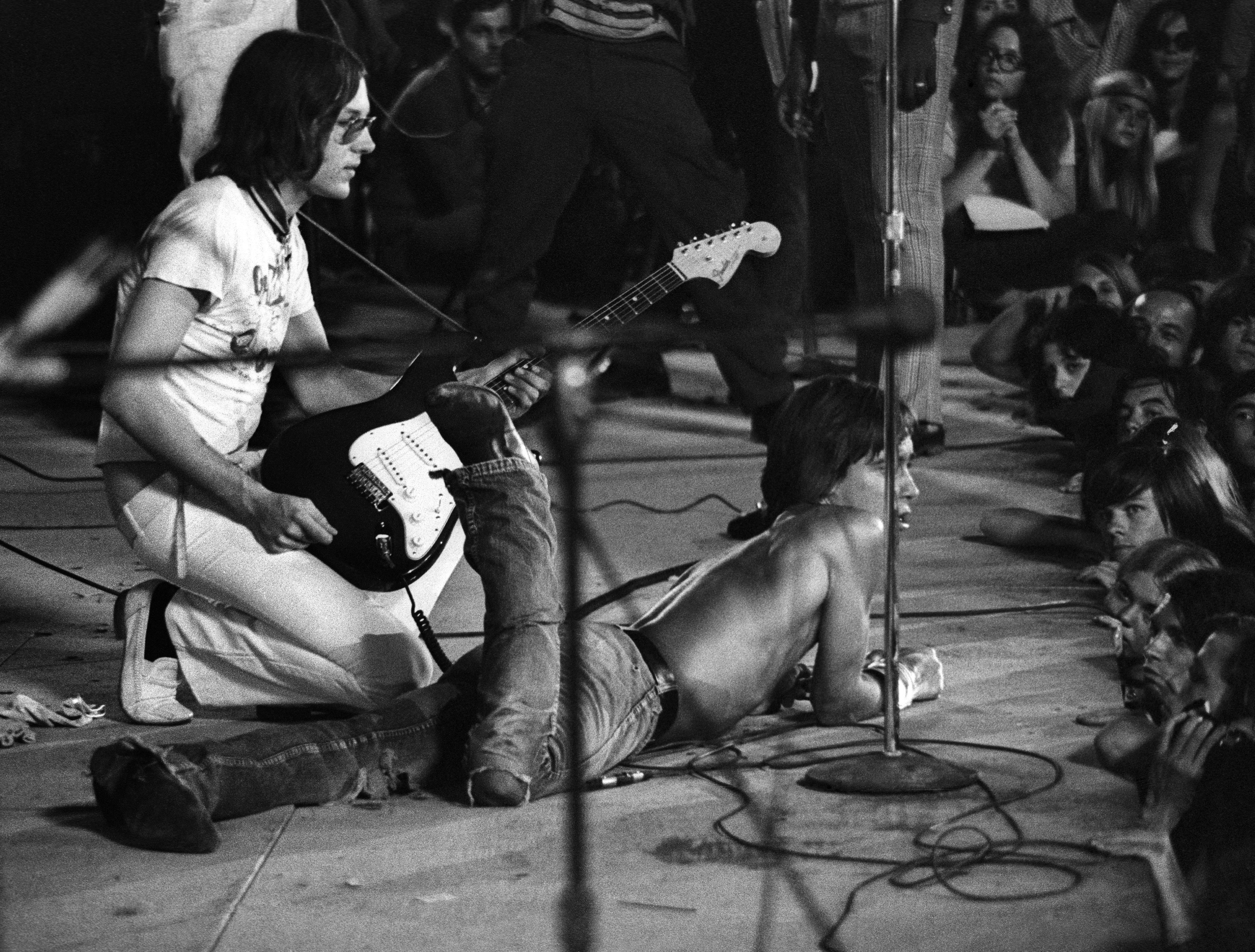 CINCINNATI - JUNE 23:  Iggy Pop and guitarist Ron Asheton of the Stooges perform live at Crosley Field on June 23, 1970 in Ci