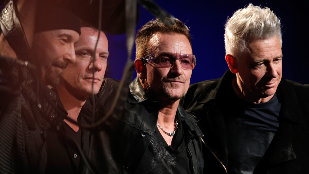 BEVERLY HILLS, CA - JANUARY 11:  The Edge, Larry Mullen Jr, Bono and Adam Clayton of U2 perform onstage during the 3rd annual