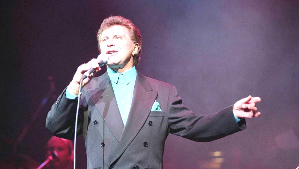 American singer Frankie Valli, former front man of The Four Seasons, performs live on stage in London in October 1994. (Photo