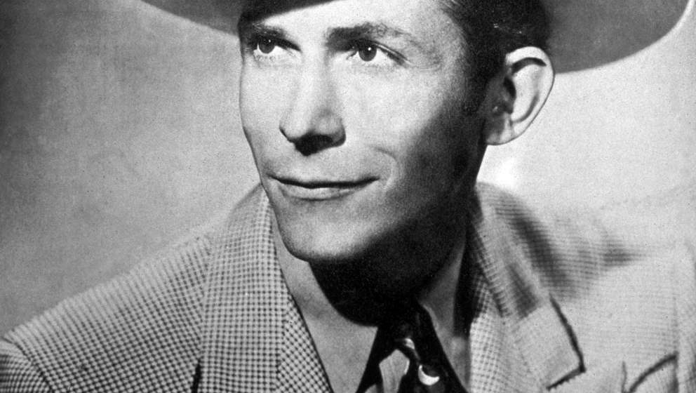 circa 1945:  Portrait of American country singer and songwriter Hank Williams (1923 - 1953) wearing a wide-brimmed coyboy hat