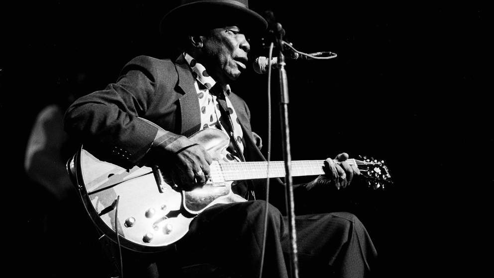 American Blues musician John Lee Hooker (1917 - 2001) performs at the Aire Crown Theater, Chicago, Illinois, October 12, 1990