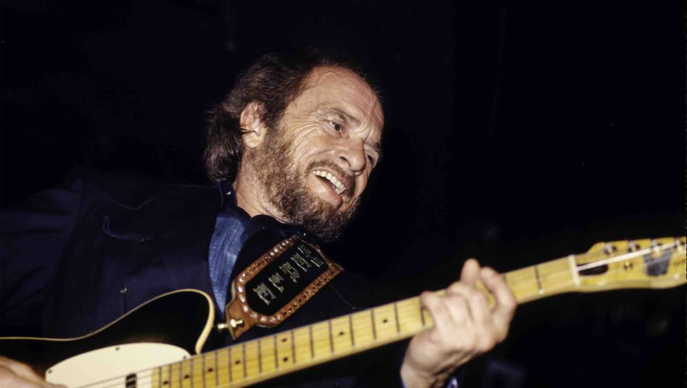 American country musician Merle Haggard leads his band the Strangers during a performance at Tramps, New York, New York, May