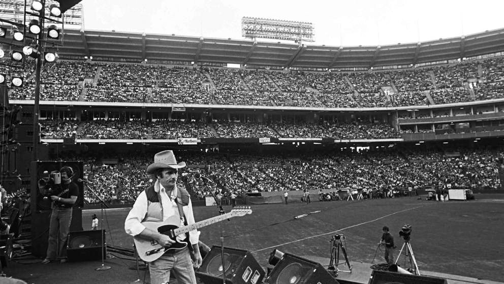 ANAHEIM, CA - 1980:  Country western singer and guitarist, Merle Haggard, performs at an outdoor 1980 Anaheim, California, co