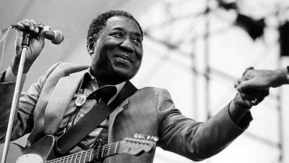 American blues musician and singer Muddy Waters (1913 - 1983) in concert, circa 1970. (Photo by Val Wilmer/Redferns/Getty Ima