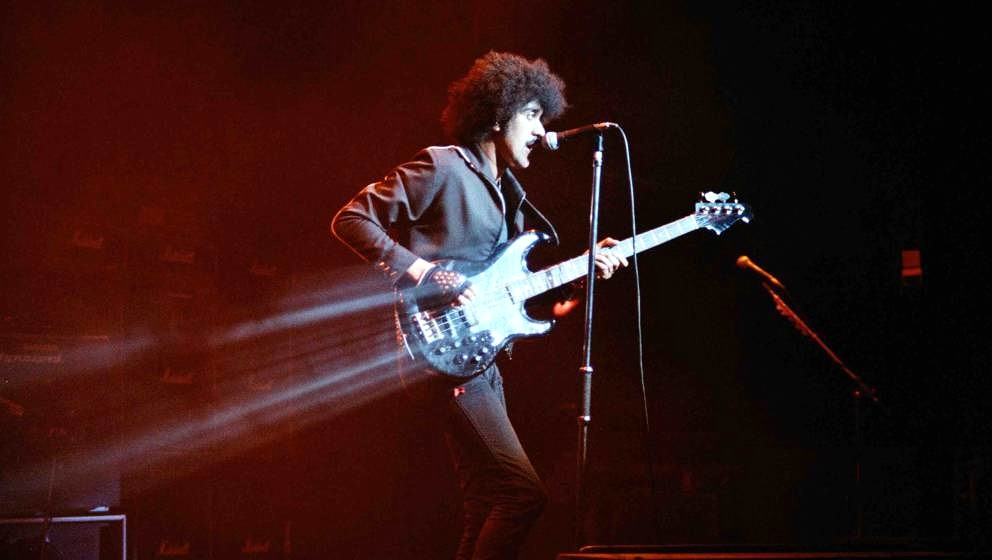 LONDON, UNITED KINGDOM - MARCH 10: Phil Lynott of Thin Lizzy performs on stage, on the 'Thunder and Lightning' tour at Hammer