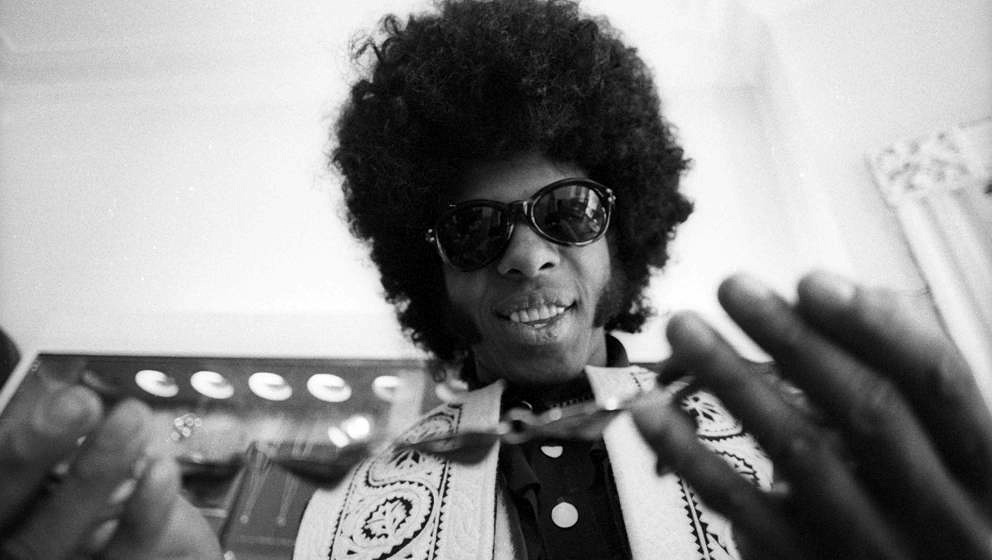 MARCH 9:  Sly Stone of the psychedelic soul group 'Sly And The Family Stone' tries on a necklace on March 9, 1969. (Photo by