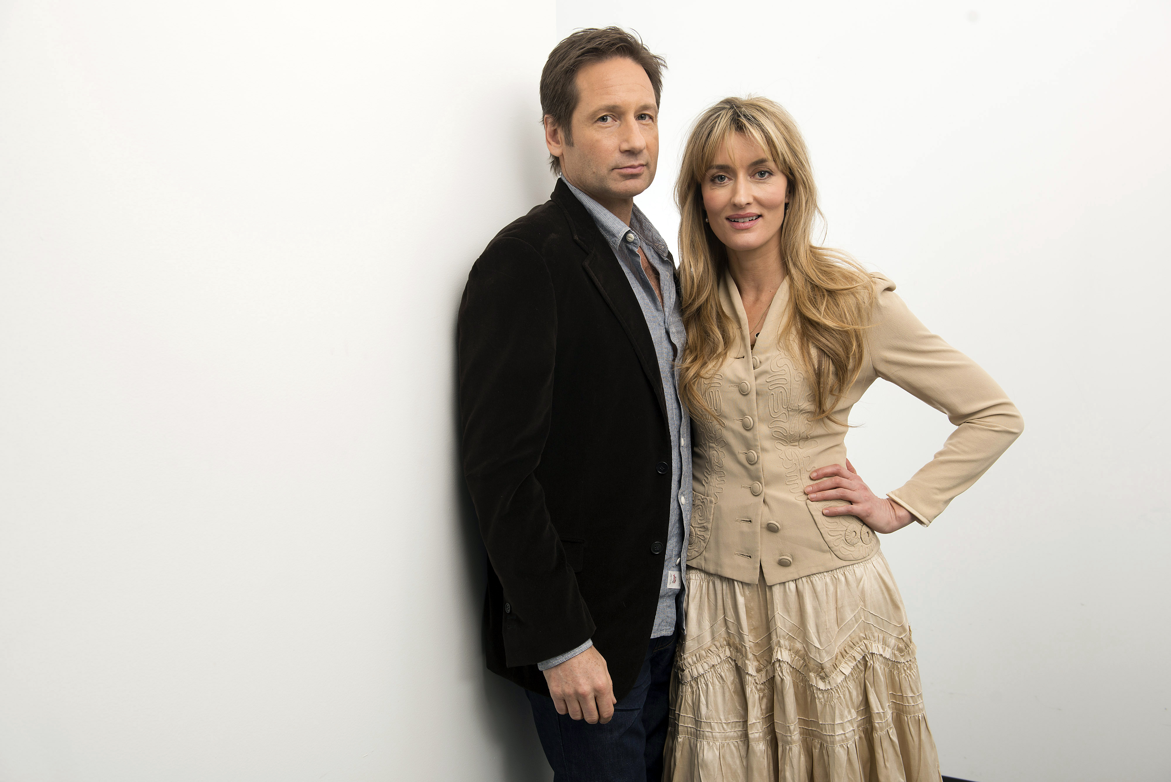 This Jan. 9, 2013 photo shows actress Natascha McElhone, right, and actor David Duchovny in New York. McElhone and Duchovny s