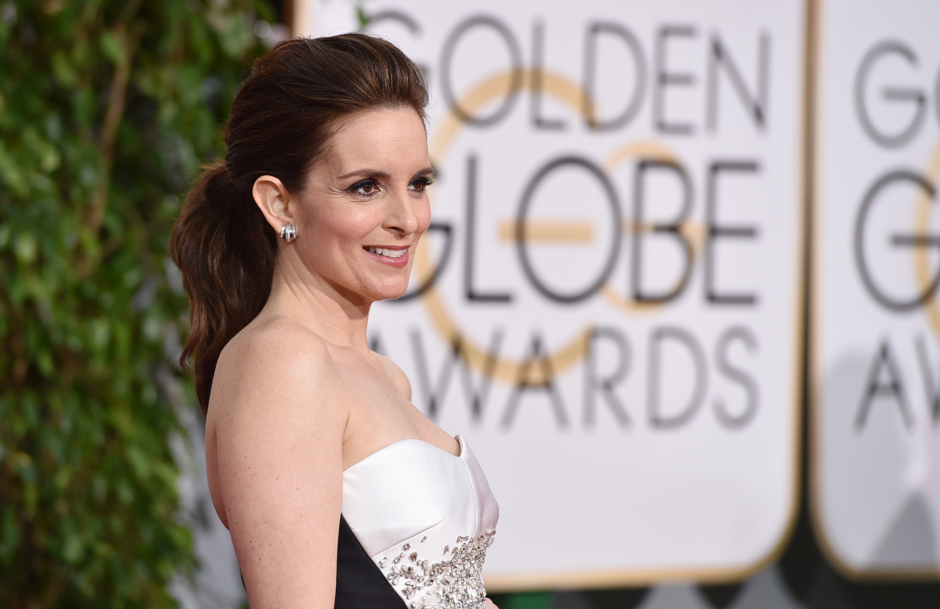 Tina Fey arrives at the 72nd annual Golden Globe Awards at the Beverly Hilton Hotel on Sunday, Jan. 11, 2015, in Beverly Hill