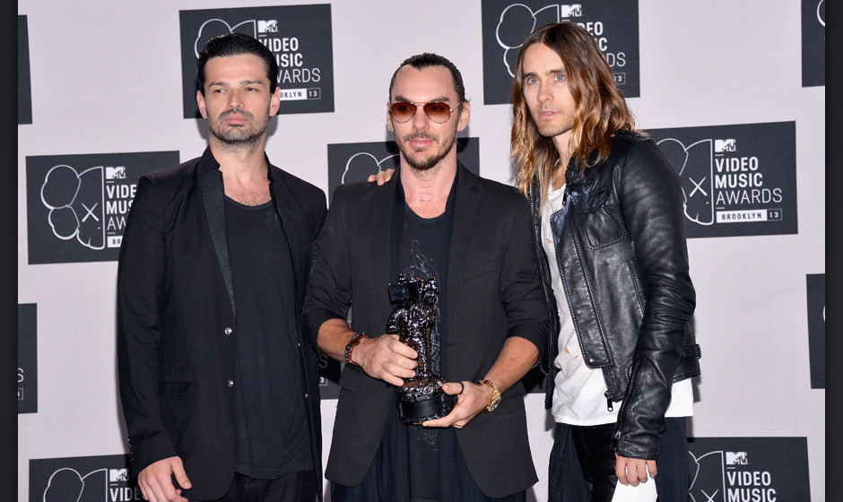 NEW YORK, NY - AUGUST 25:  Tomo Milicevic, Shannon Leto and Jared Leto of Thirty Seconds to Mars attend the 2013 MTV Video Mu