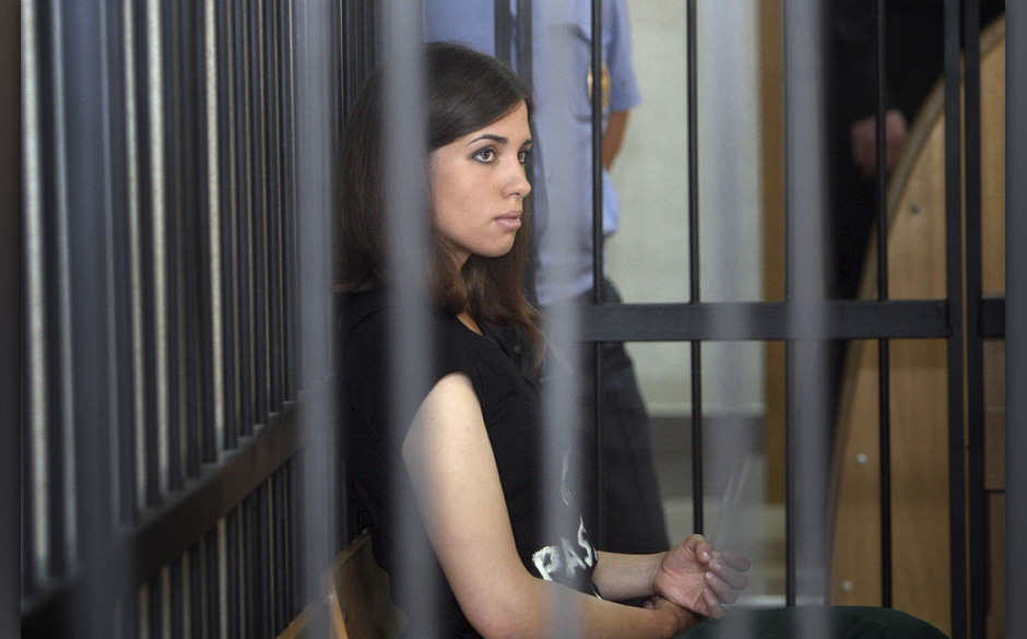 FILE - In this Friday, July 26, 2013 file photo Nadezhda Tolokonnikova, foreground right, a member of the feminist punk band,
