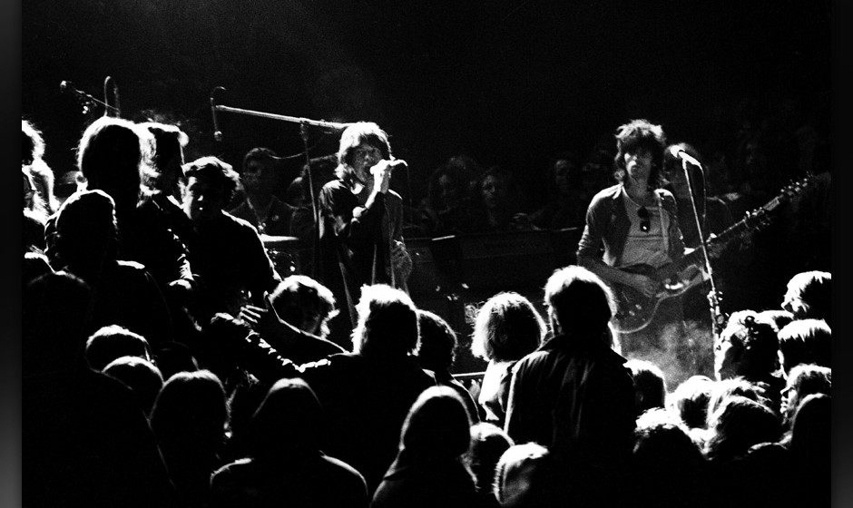 LIVERMORE, CA - DECEMBER 6:  Mick Jagger and Keith Richards of the Rolling Stones warily eye the Hells Angels onstage at The