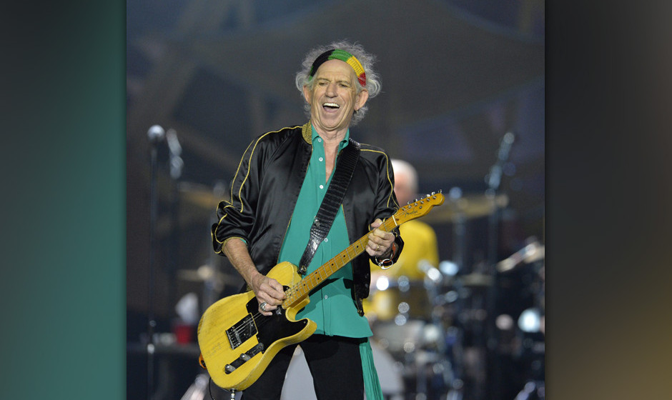 epa04294432 Guitarist Keith Richards of British rock band The Rolling Stones performs during a concert of their 'On Fire' wor
