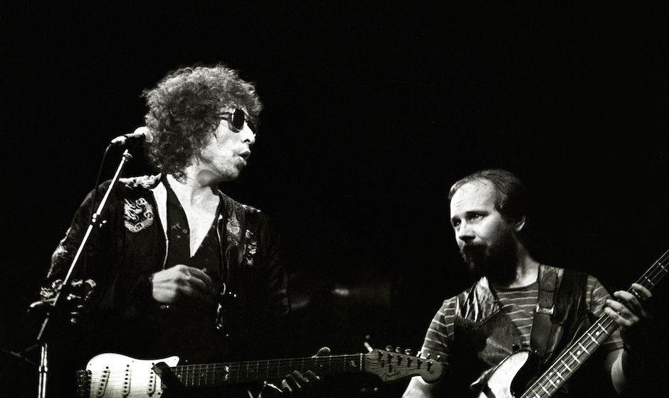 UNITED KINGDOM - JULY 01:  EARLS COURT  Photo of Bob DYLAN and Tim DRUMMOND, Bob Dylan and Tim Drummond (R) performing on sta