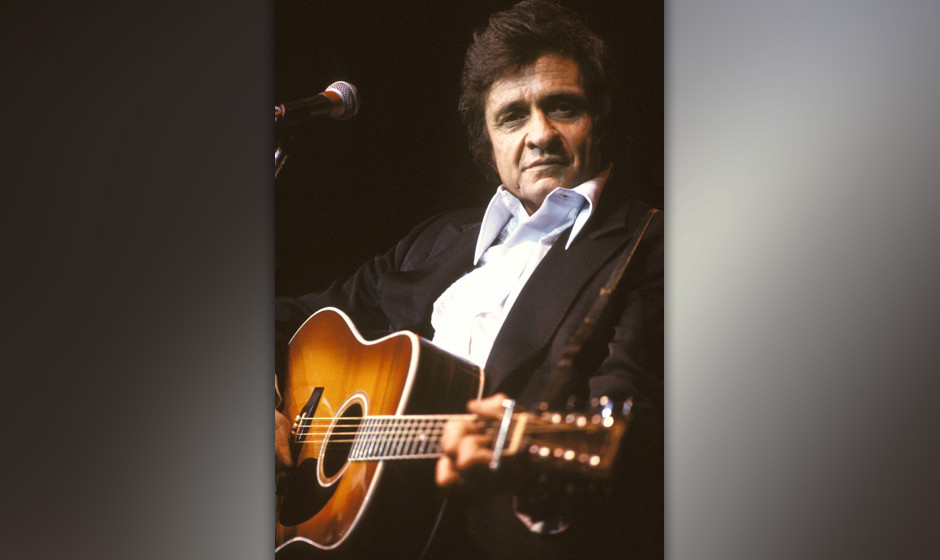 UNITED KINGDOM - MARCH 01:  Photo of Johnny CASH; Johnny Cash performing on stage at the Festival of Country Music David Redf