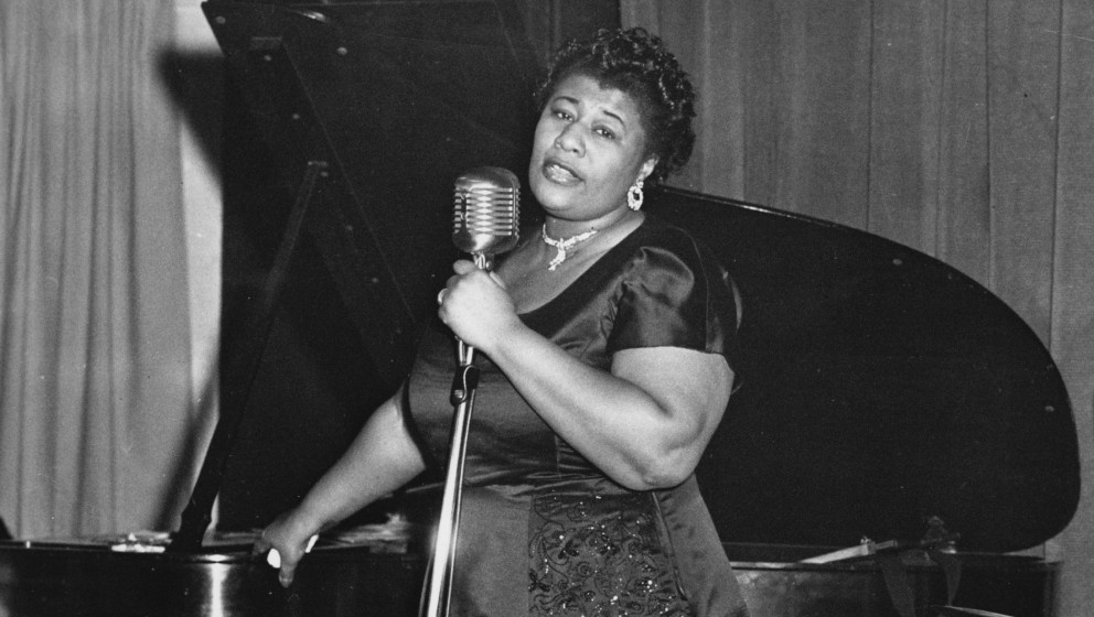 Ella Fitzgerald performs on stage, USA, 1955. (Photo by Gilles Petard/Redferns)