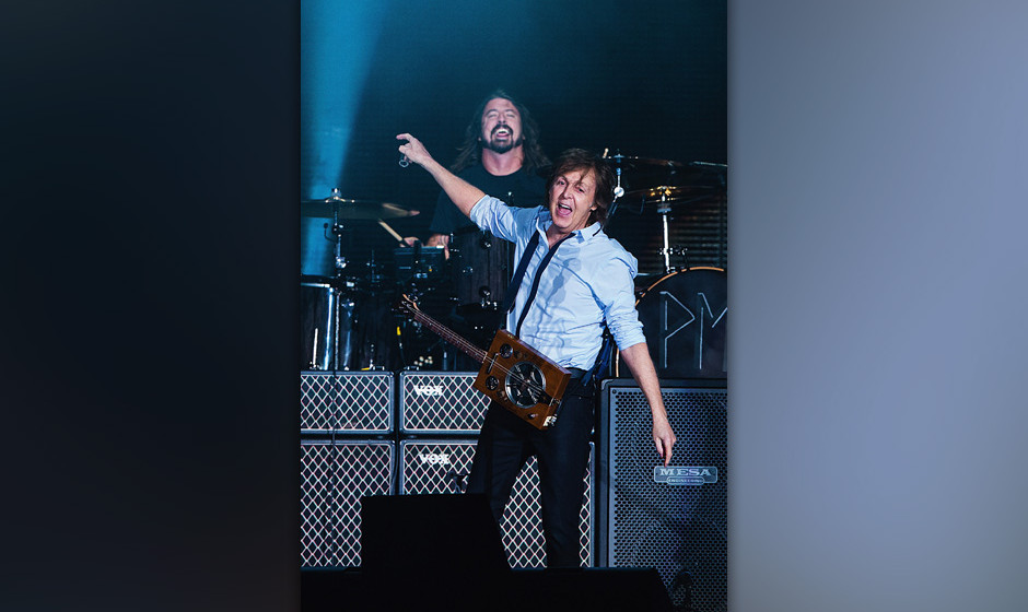 SEATTLE, WA - JULY 19:  Dave Grohl (L) and Sir Paul McCartney (R) perform on stage at Safeco Field on July 19, 2013 in Seattl