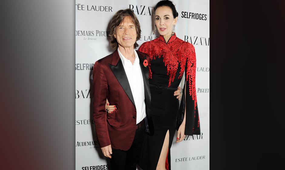 LONDON, ENGLAND - NOVEMBER 05:  Sir Mick Jagger (L) and L'Wren Scott arrive at the Harper's Bazaar Women of the Year awards a