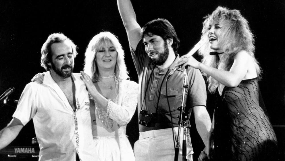 SAN BERNARDINO, CA - MAY 1983:  (L-R) John McVie, Christine McVie, organizer and executive Steve Wozniak and Stevie Nicks of