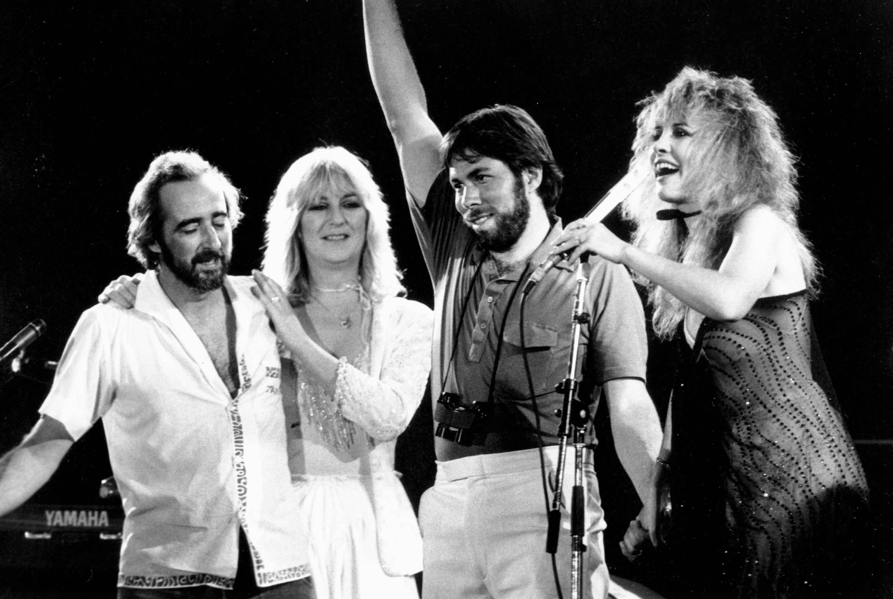 SAN BERNARDINO, CA - MAY 1983:  (L-R) John McVie, Christine McVie, organizer and executive Steve Wozniak and Stevie Nicks of