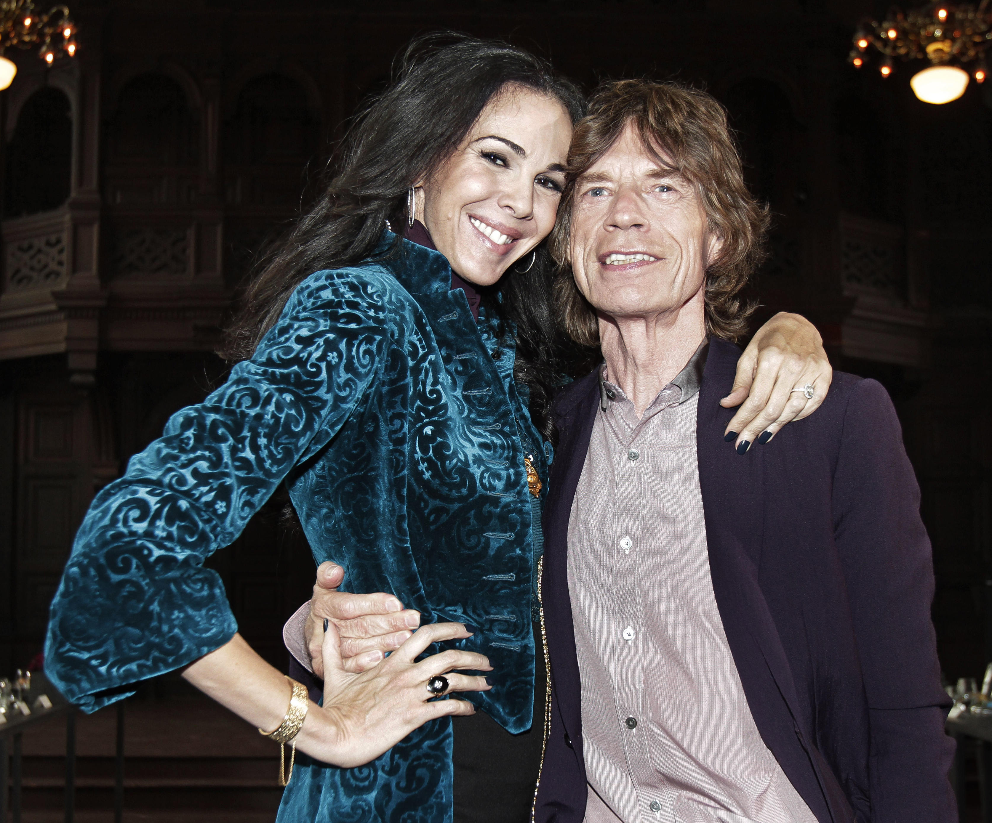 FILE - This Feb. 16, 2012 file photo shows singer Mick Jagger, right, with designer L¿Wren Scott after her Fall 2012 collect