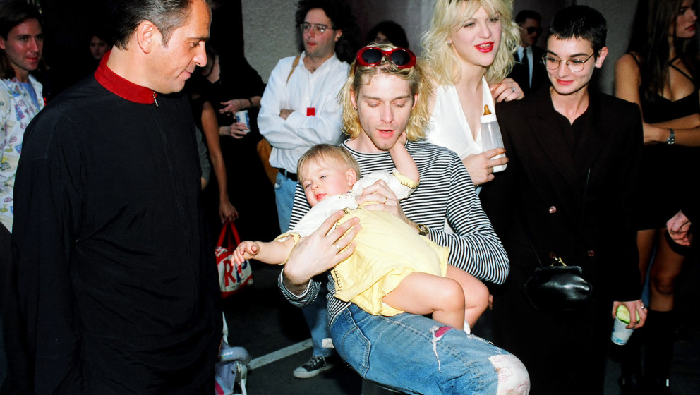 Peter Gabriel, Kurt Cobain of Nirvana with wife Courtney Love and daughter Frances Bean Cobain, and Sinead O'Connor (Photo by