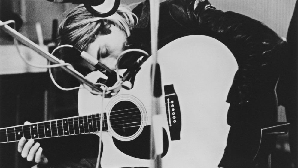 Singer-songwriter and guitarist Kurt Cobain (1967 - 1994), of American grunge band Nirvana, playing a Takamine acoustic guita