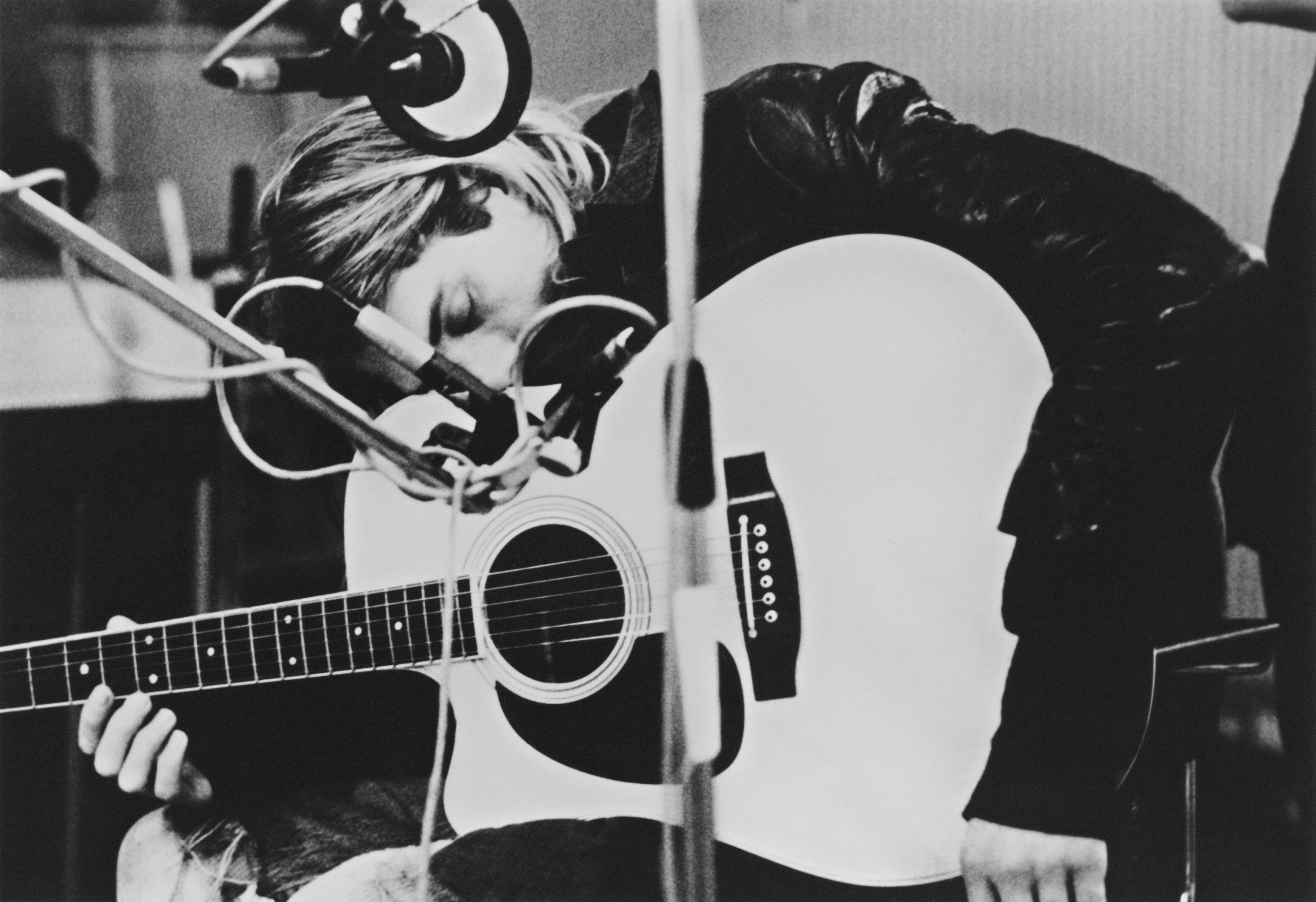 Singer-songwriter and guitarist Kurt Cobain (1967 - 1994), of American grunge band Nirvana, playing a Takamine acoustic guita