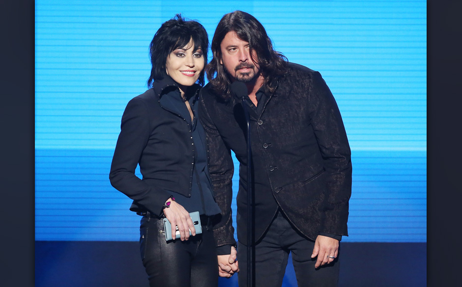 LOS ANGELES, CA - NOVEMBER 24:  Joan Jett and Dave Grohl speak onstage at the 2013 American Music Awards held at Nokia Theatr