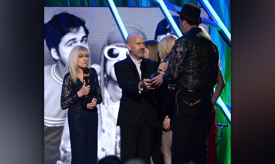 NEW YORK, NY - APRIL 10:  Michael Stipe (C) honors Krist Novoselic of Nirvana onstage with Wendy O'Connor at the 29th Annual