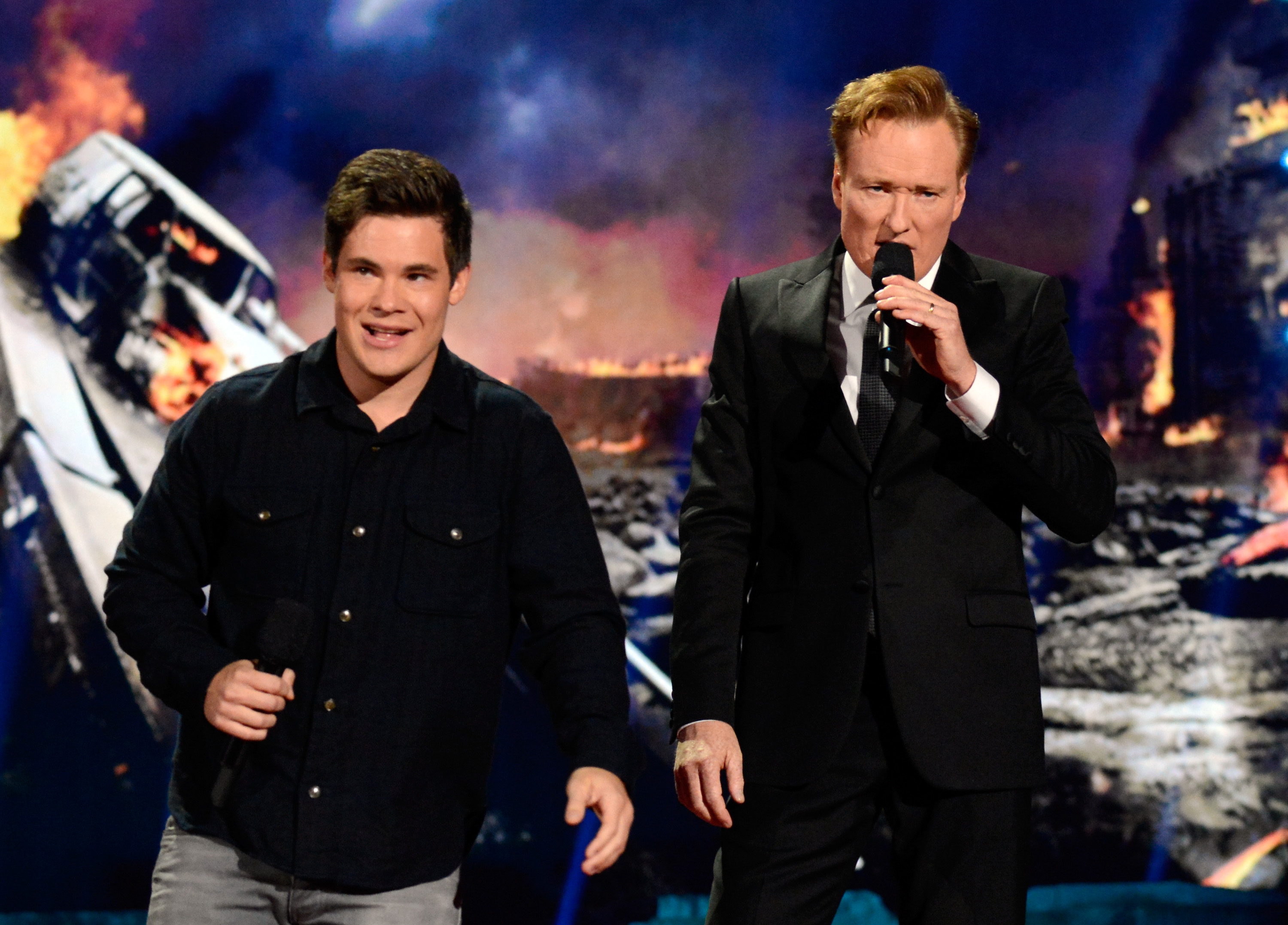 LOS ANGELES, CA - APRIL 13:  Actor Adam DeVine (L) and host Conan O'Brien speak onstage at the 2014 MTV Movie Awards at Nokia