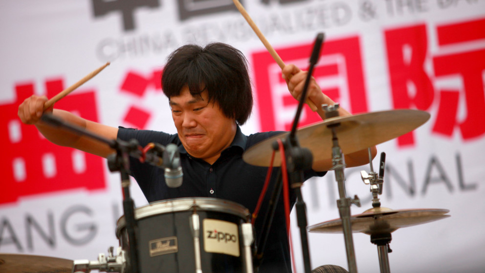 XIAN, CHINA - SEPTEMBER 5: (CHINA OUT) Zhang Yang, the drummer of Chinese band Second Hand Rose, performs at the 'China Revis