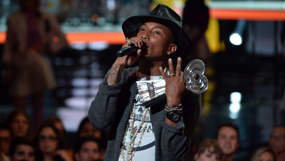 LOS ANGELES, CA - MAY 01:  Musician Pharrell Williams accepts the iHeartRadio Innovator Award onstage during the 2014 iHeartR