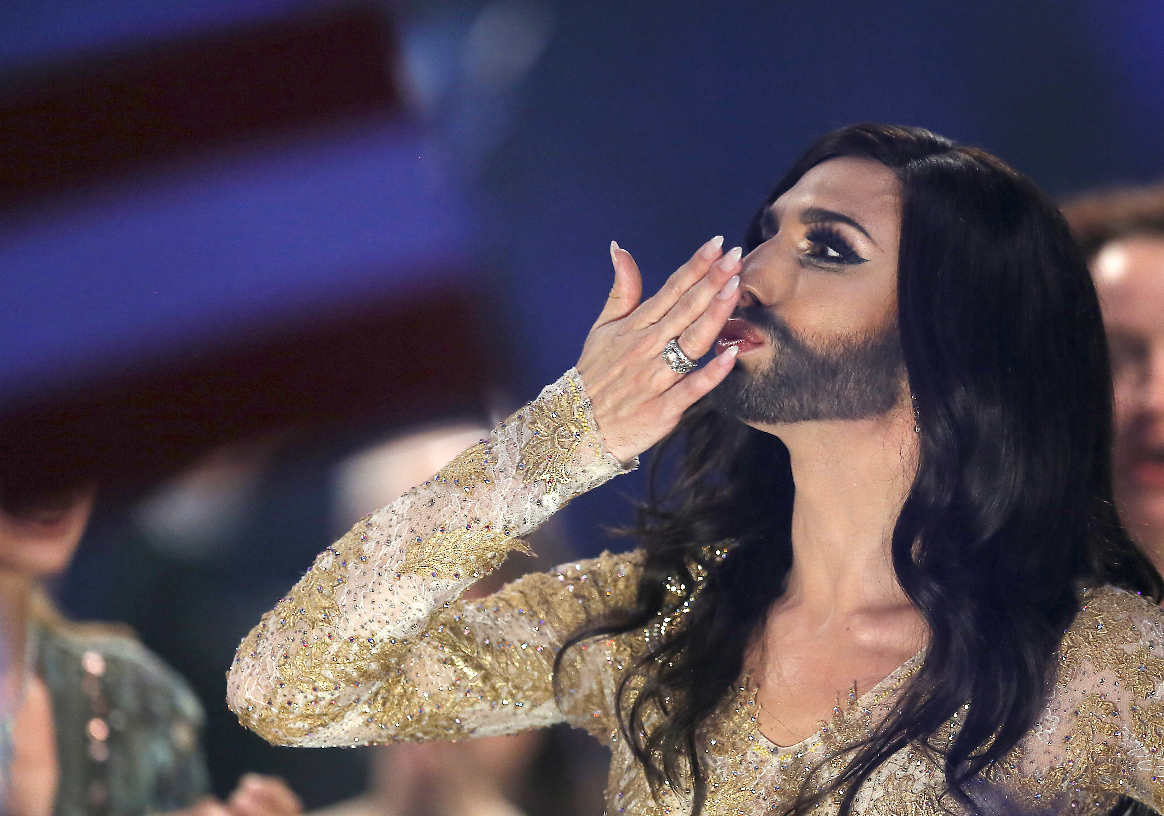 Conchita Wurst representing Austria celebrates after the second semifinal of the Eurovision Song Contest in the B&W Halls