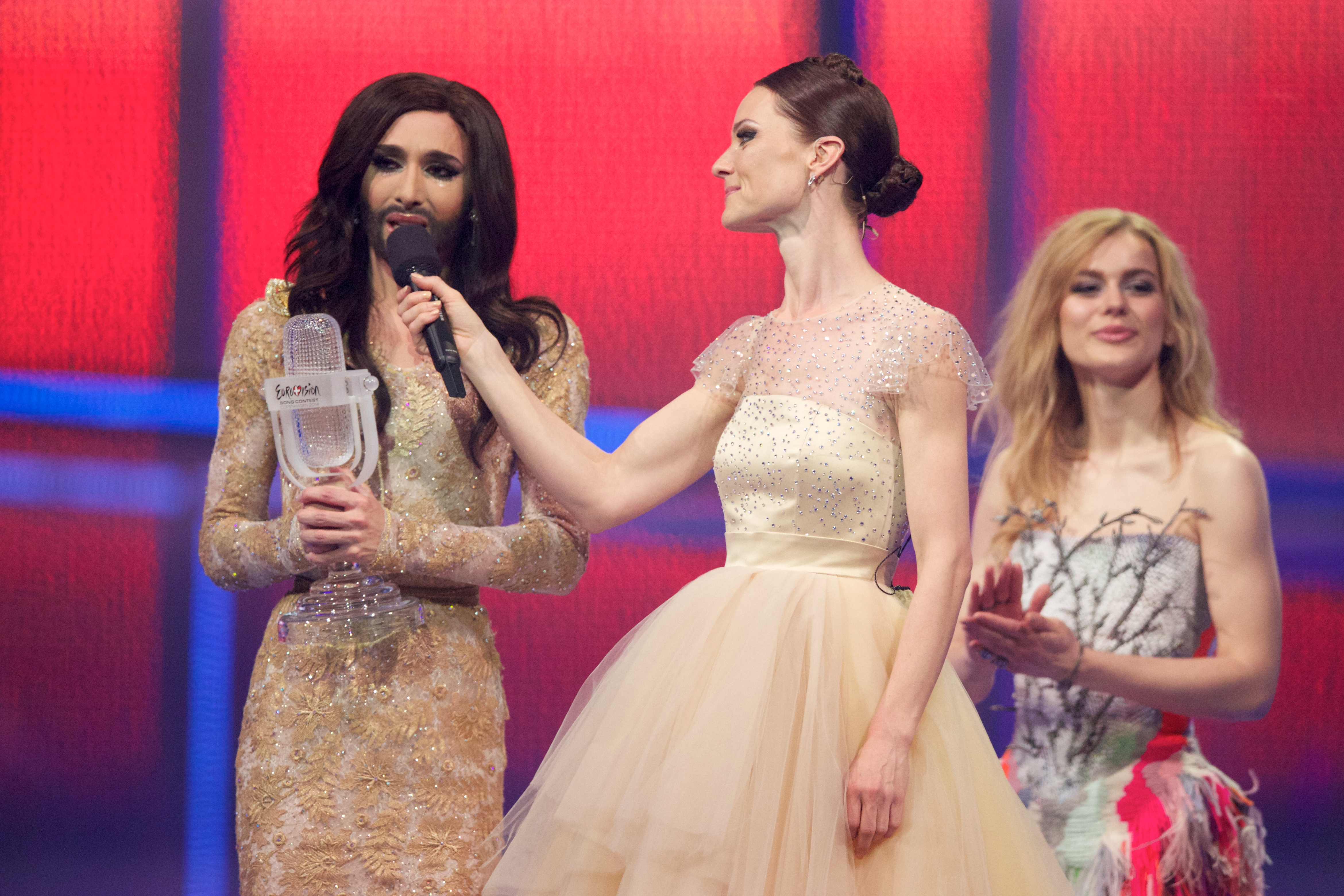 COPENHAGEN, DENMARK - MAY 10: Winner of 2014 Eurovision Song Contest Conchita Wurst of Austria, hostess Lise Ronne and the wi