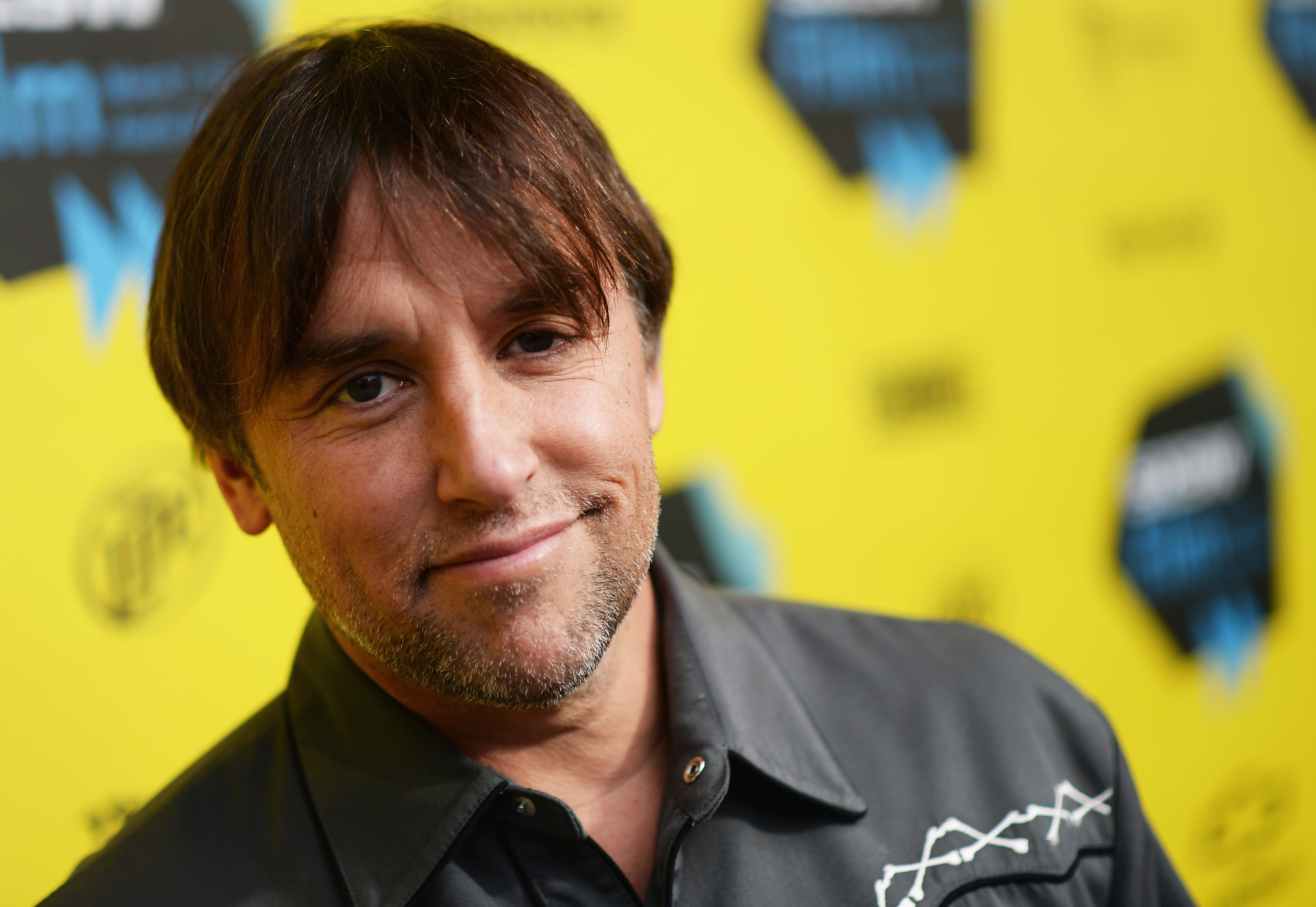AUSTIN, TX - MARCH 09:  Director Richard Linklater arrives at the premiere of 'Boyhood' at the 2014 SXSW Music, Film + Intera