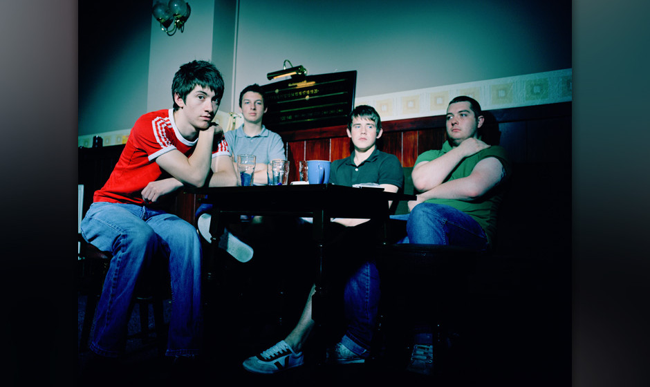 English indie rock band Arctic Monkeys in a pub, 2006. Left to right: singer Alex Turner, drummer Matt Helders, guitarist Jam