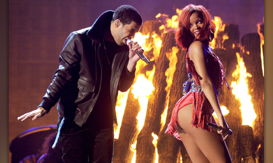 LOS ANGELES, CA - FEBRUARY 13:  Singers Drake (L) and Rihanna perform onstage during The 53rd Annual GRAMMY Awards held at St