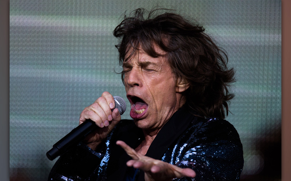 Rolling Stones singer Mick Jagger performs during a concert in Berlin, Tuesday, June 10, 2014.  The concert at the Waldbuehne