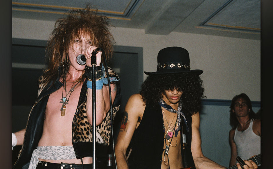 LOS ANGELES - JULY 21:  (L-R) Axl Rose and Slash of the rock band 'Guns n' Roses' perform onstage at a UCLA frat party where