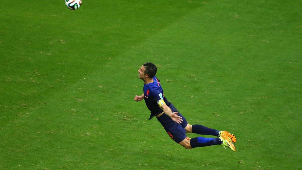 SALVADOR, BRAZIL - JUNE 13:  Robin van Persie of the Netherlands scores the team's first goal with a diving header in the fir