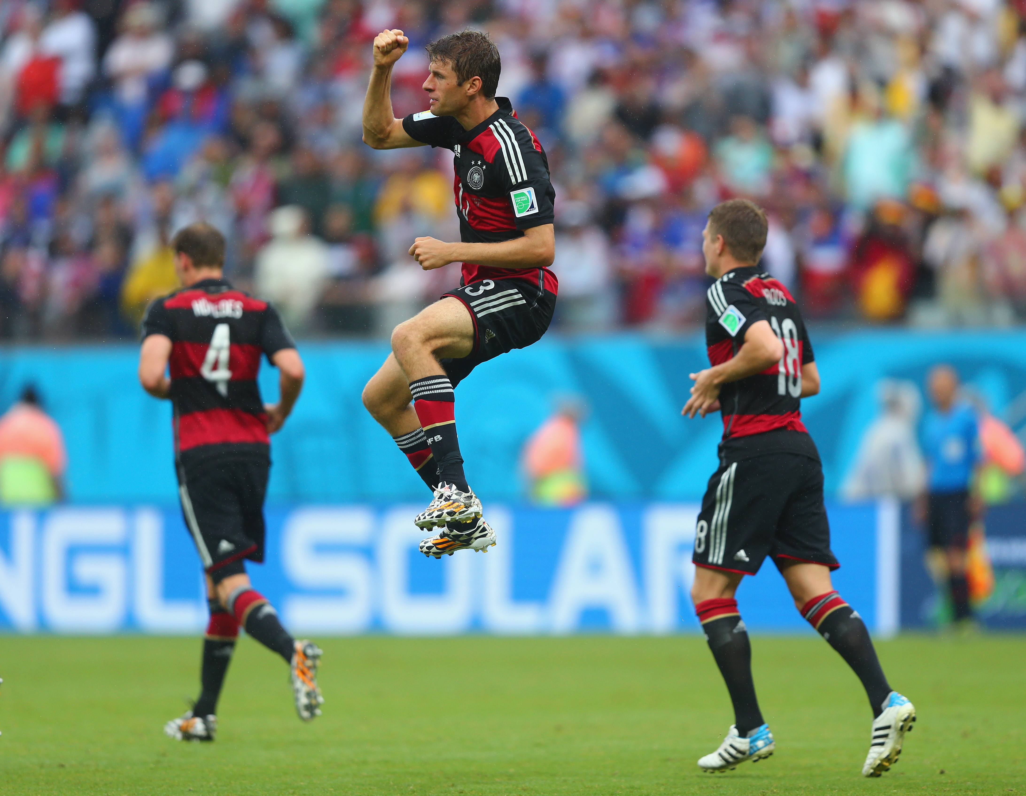RECIFE, BRAZIL - JUNE 26:  Thomas Mueller of Germany (C) celebrates scoring his team's first goal during the 2014 FIFA World