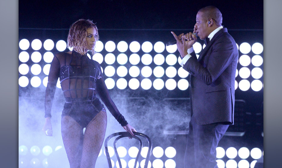 LOS ANGELES, CA - JANUARY 26:  Singer Beyonce and rapper Jay Z perform onstage during the 56th GRAMMY Awards at Staples Cente