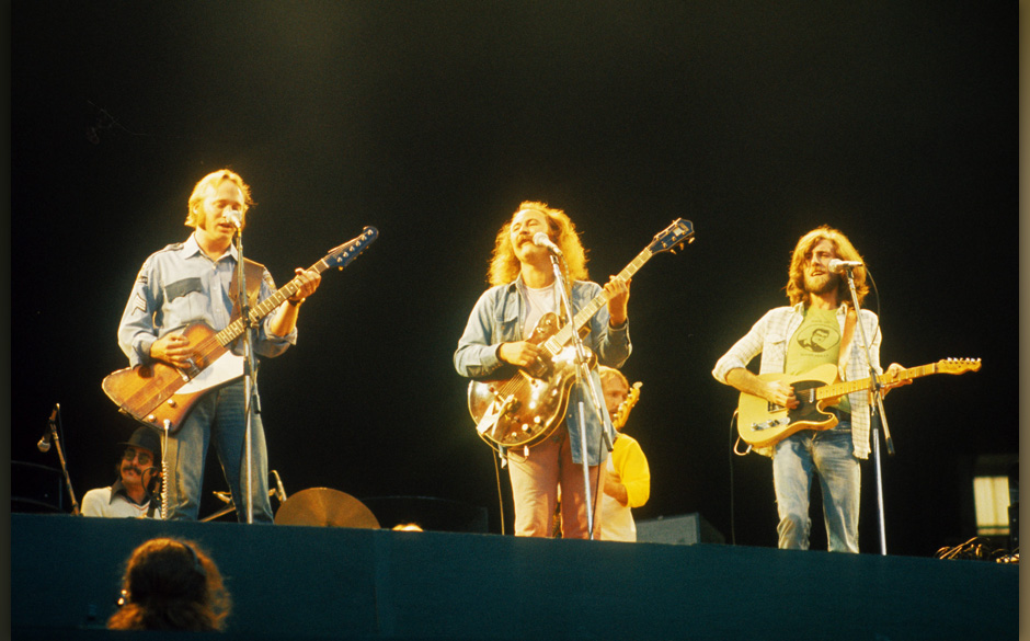 (L-R) Stephen Stills, David Crosby and Graham Nash of Crosby Stills Nash And Young perform on stage at Wembley Stadium on 14t