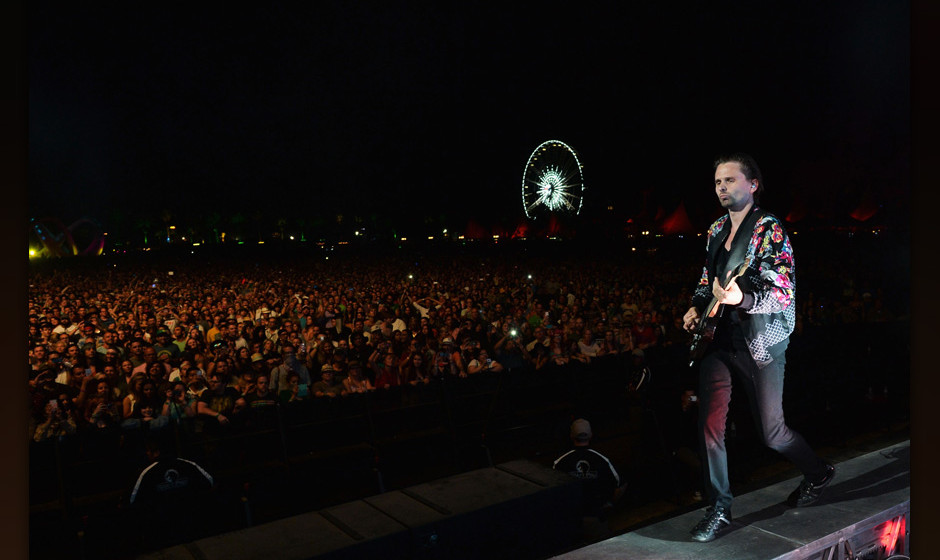 INDIO, CA - APRIL 19:  Musician Matthew Bellamy of Muse performs onstage during day 2 of the 2014 Coachella Valley Music &