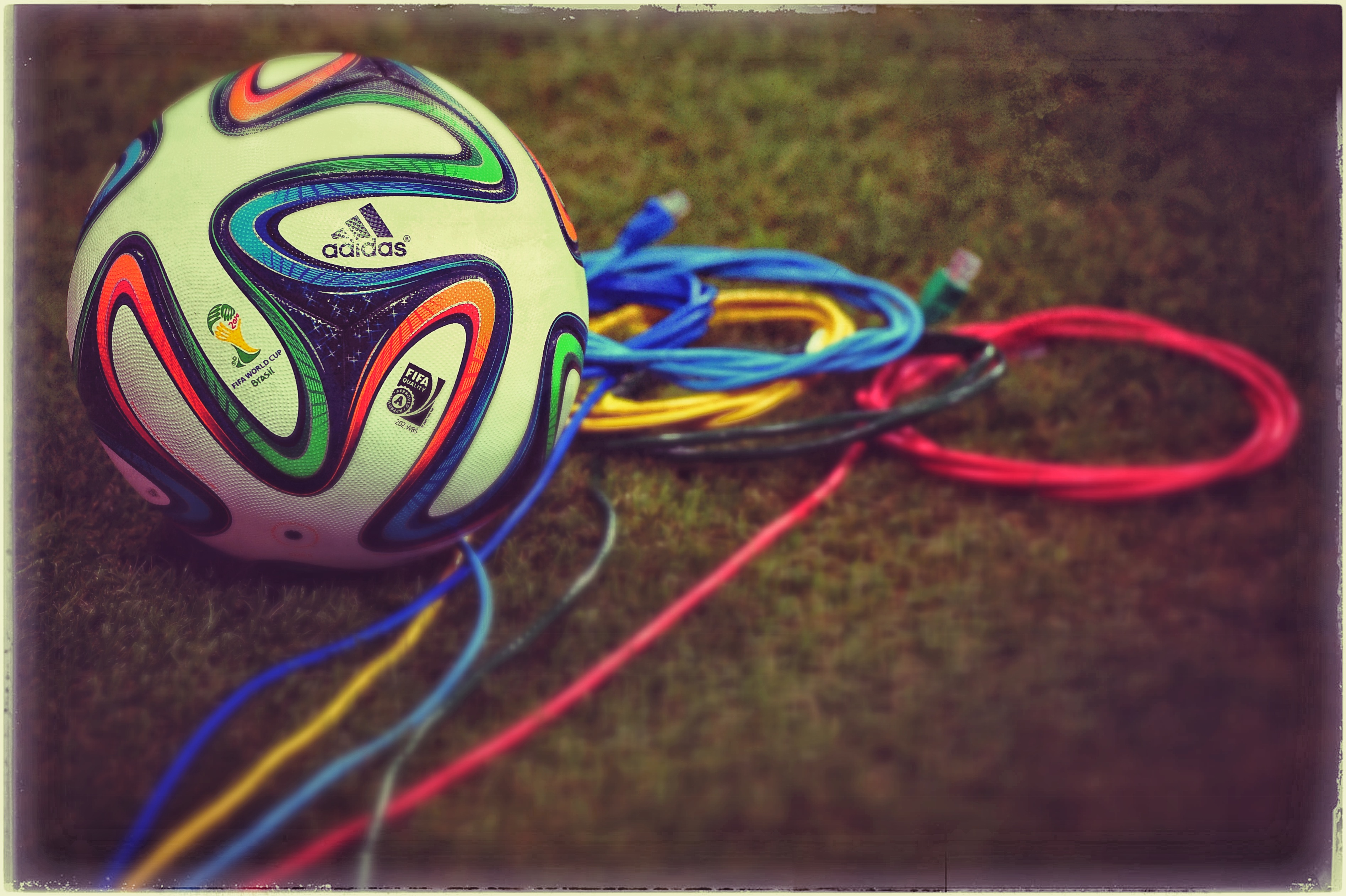 SALVADOR, BRAZIL - JUNE 12: (EDITORS NOTE: THIS IMAGES HAS BEEN CREATED WITH THE USE OF DIGITAL FILTERS)  A Brazuca ball is s