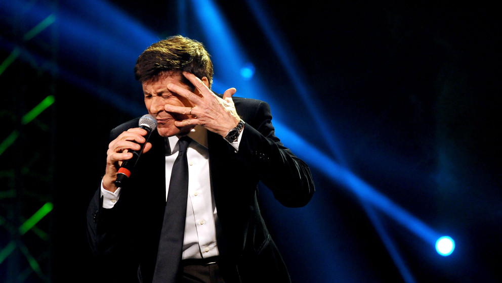 BOLOGNA, ITALY - MARCH 04:  Italian vocalist Gianni Morandi performs the Lucio Dalla Tribute at Piazza Maggiore on March 4, 2