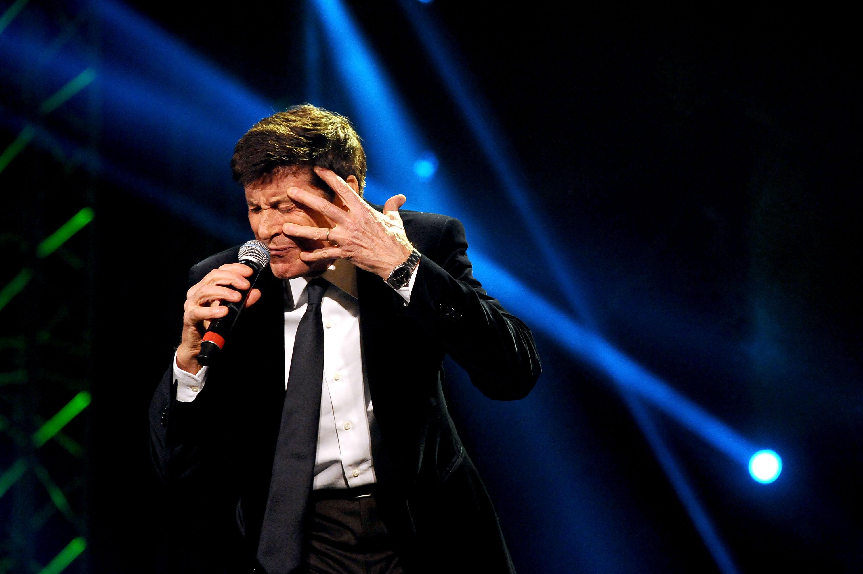BOLOGNA, ITALY - MARCH 04:  Italian vocalist Gianni Morandi performs the Lucio Dalla Tribute at Piazza Maggiore on March 4, 2